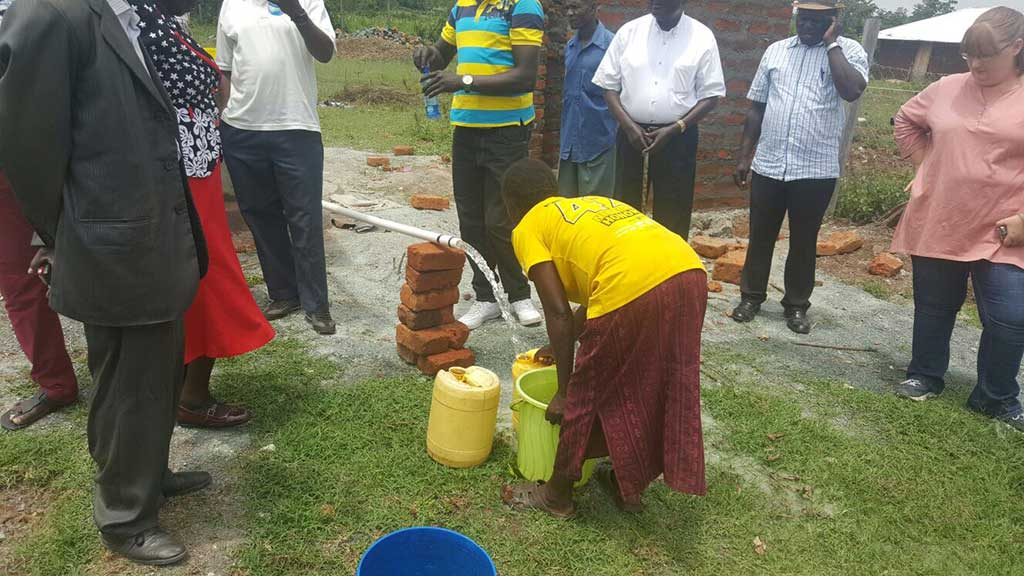 Gathering-some-drinking-water-from-Well-project-in-Onjinyo-at-KEGO-Orphanage