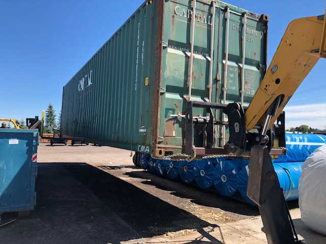 Container-being-lifted-for-shipping-to-Onjinyo-Kenya