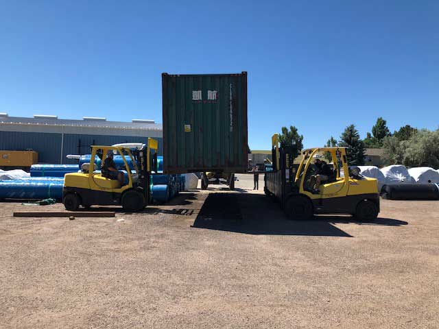 Container-being-lifted-so-it-can-be-shipped-2