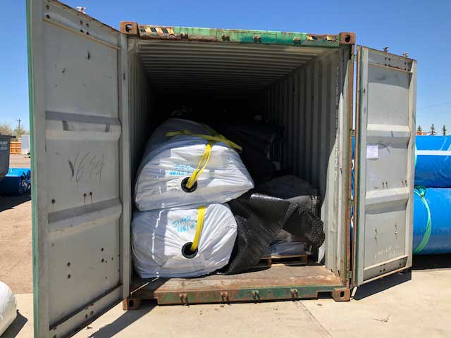Container-full-of-liners-and-supplies-for-earth-gardens-in-Onjinyo