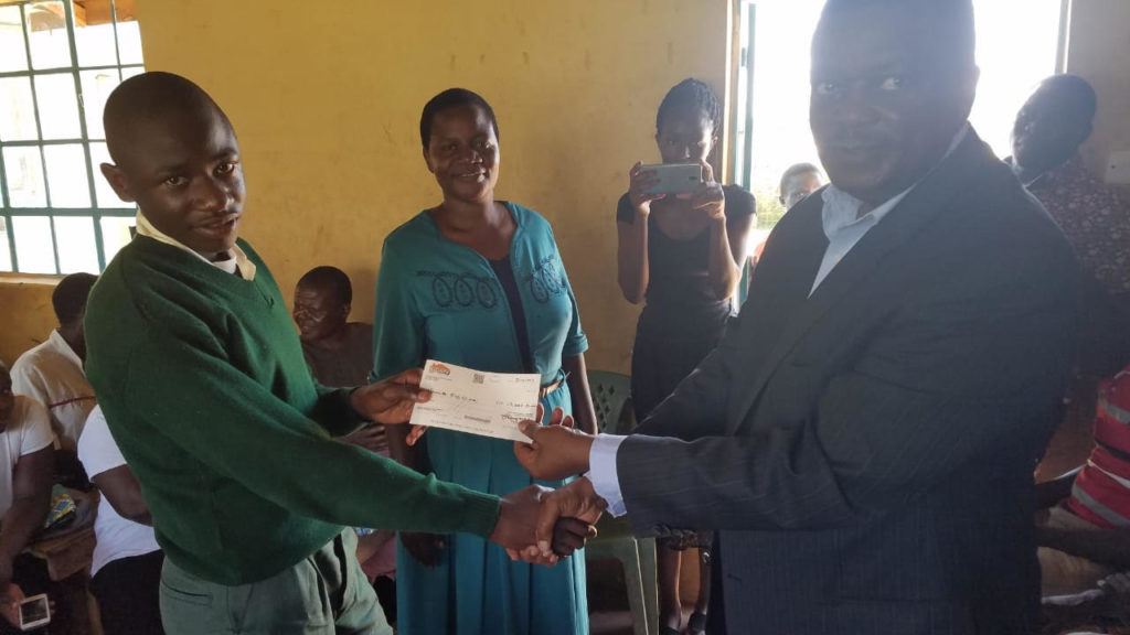 Check being given to student with best test score in the country